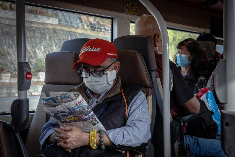 Elderly Man with surgical mask on bus